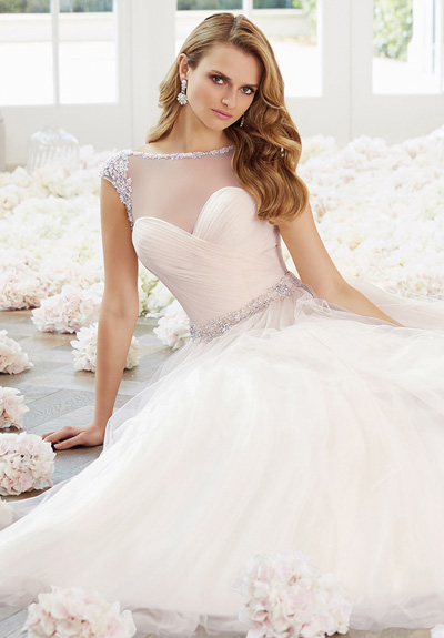 ce200452240ad The Ronald Joyce Bridal collection is strikingly beautiful. Inspired by the  glamorous 1930's and theatrical 20's era.